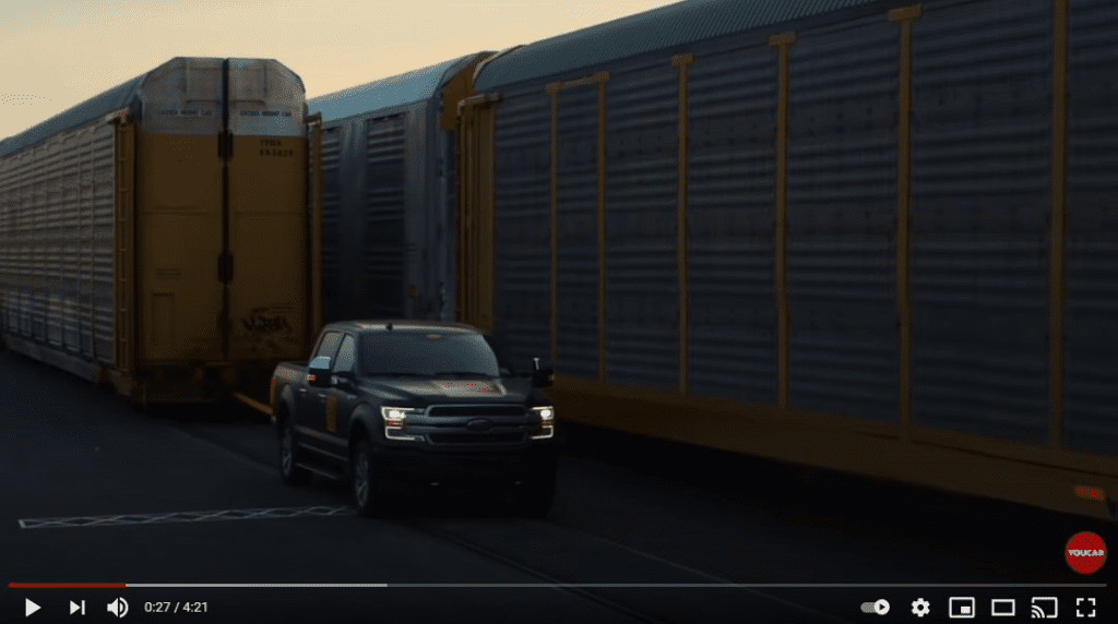 Ford puts it's electric F-150 on show pulling a loaded train